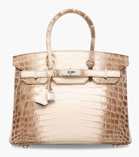 **The most expensive Birkin in the world sold for $380,000 USD.** <br><br> In May, Christie's set a world record when this matte crocodile Birkin with diamond-encrusted hardware sold at auction for $380,000 USD.