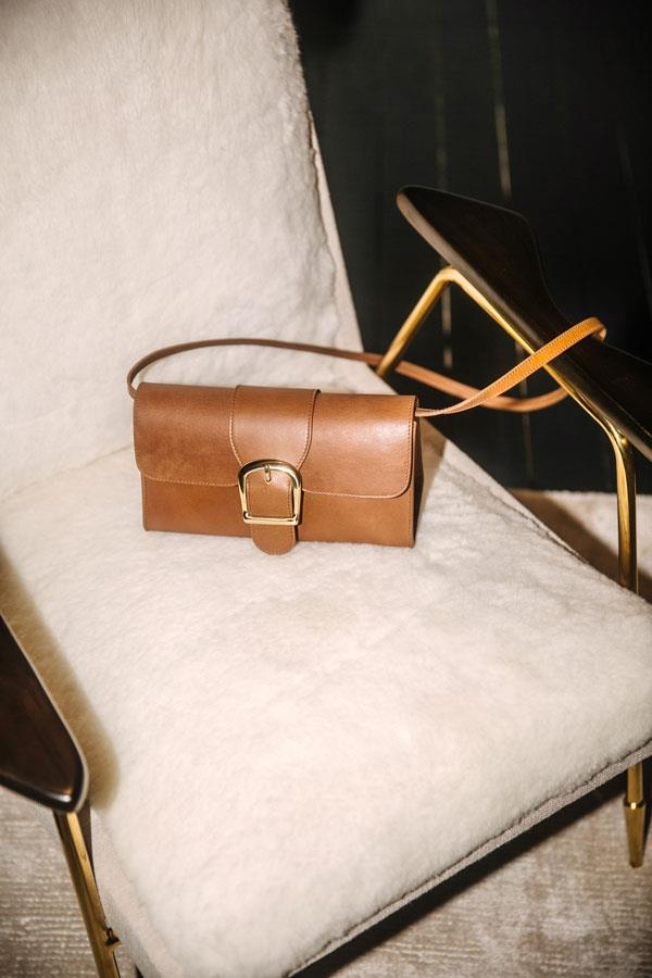 "2.2 Small cognac bag, $690 at [Rylan Studio](https://rylan.studio/product/2-2-handbag-cognac/|target=""_blank"")"
