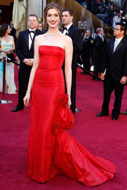 **ANNE HATHAWAY IN VALENTINO—approx. $102,000** <br><br> The red Valentino gown that Anne Hathaway wore when she presented the 2011 Oscars cost approx. $102,000, which she then teamed with a Tiffany & Co necklace worth approx. $13 million.