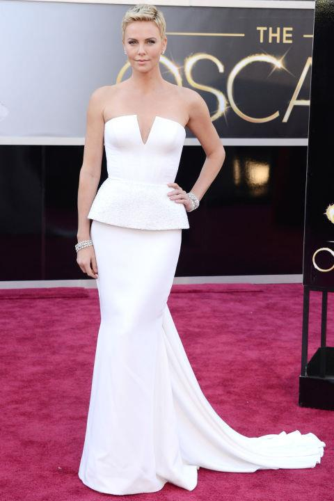 **CHARLIZE THERON IN DIOR—approx. $127,000** <br><br> Charlize Theron increased the value of her 2013 Oscars look by teaming her structured Dior gown with Harry Winston diamond cuffs, worth approx. $508,000.