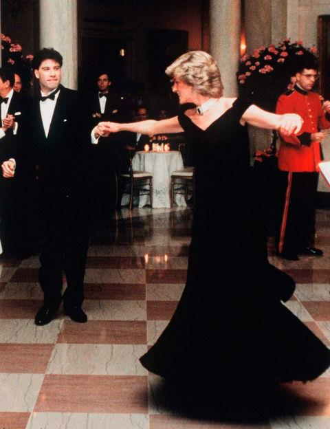 **DIANA PRINCESS OF WALES IN VICTOR EDELSTEIN—approx. $300,000** <br><br> Unsurprisingly, the velvet off-the-shoulder dress that Diana, Princess of Wales, wore to dance with John Travolta in at President Raegan's White House Dinner in 1995 was sold for a huge amount at auction. In 1997, the gown sold for approx. $127,000, then again in 2013 for approx. $300,000.