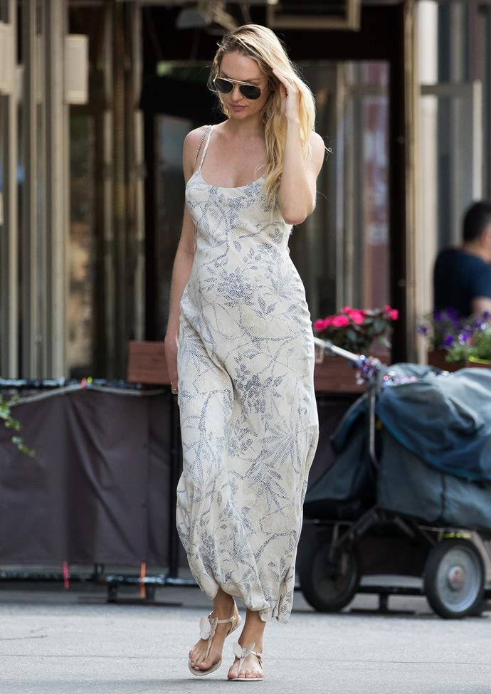 **Candice Swanepoel**, who was pregnant with her first son when this picture was taken, proves a bohemian-inspired maxi dress never goes out of style.