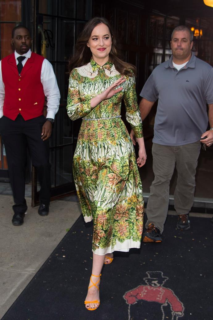**Dakota Johnson** is all-class in this silk, mid-length dress by Gucci. Added points for the playful sandals.