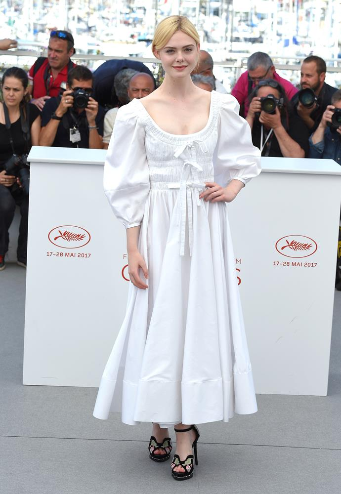 **Elle Fanning** makes a case for the prairie dress in Alexander McQueen, while promoting *The Beguiled* at Cannes.