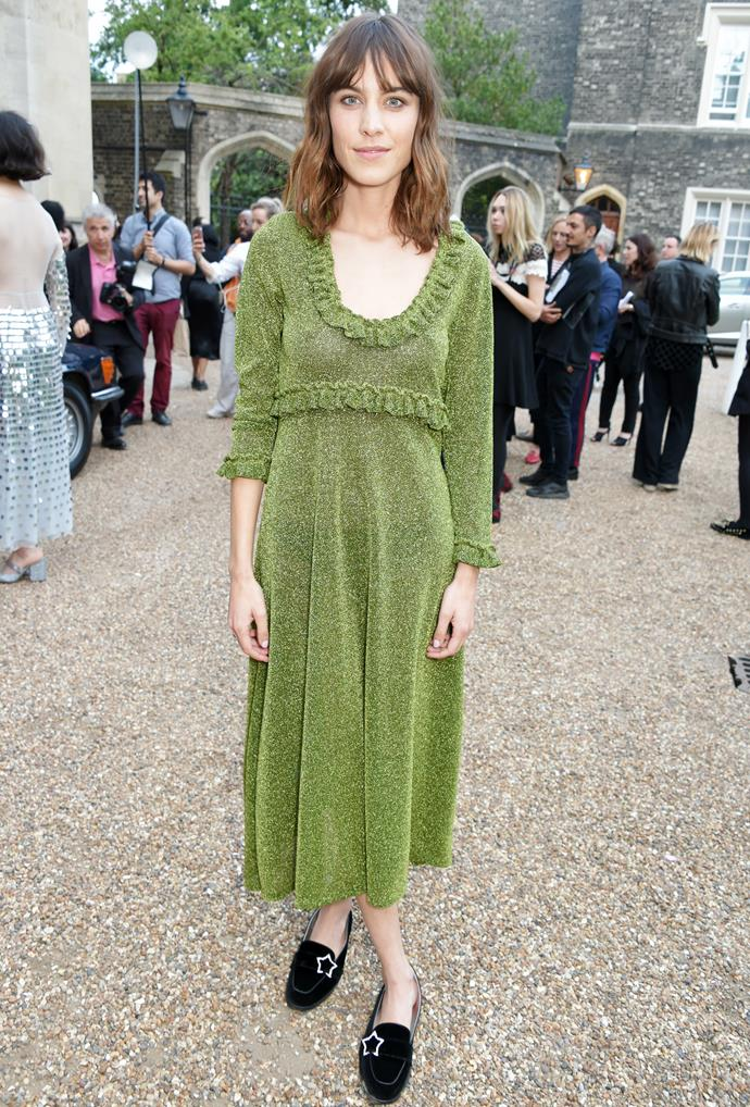 **Alexa Chung** wears a dress from the first collection of her eponymous label, Alexachung, at the brand's launch. And now we officially love moss green.
