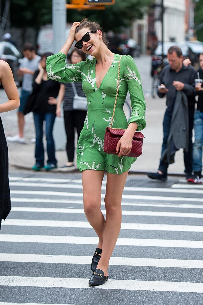 Top model **Georgia Fowler** is carefree in New York, wearing a Realisation Par tea dress and Gucci loafers.