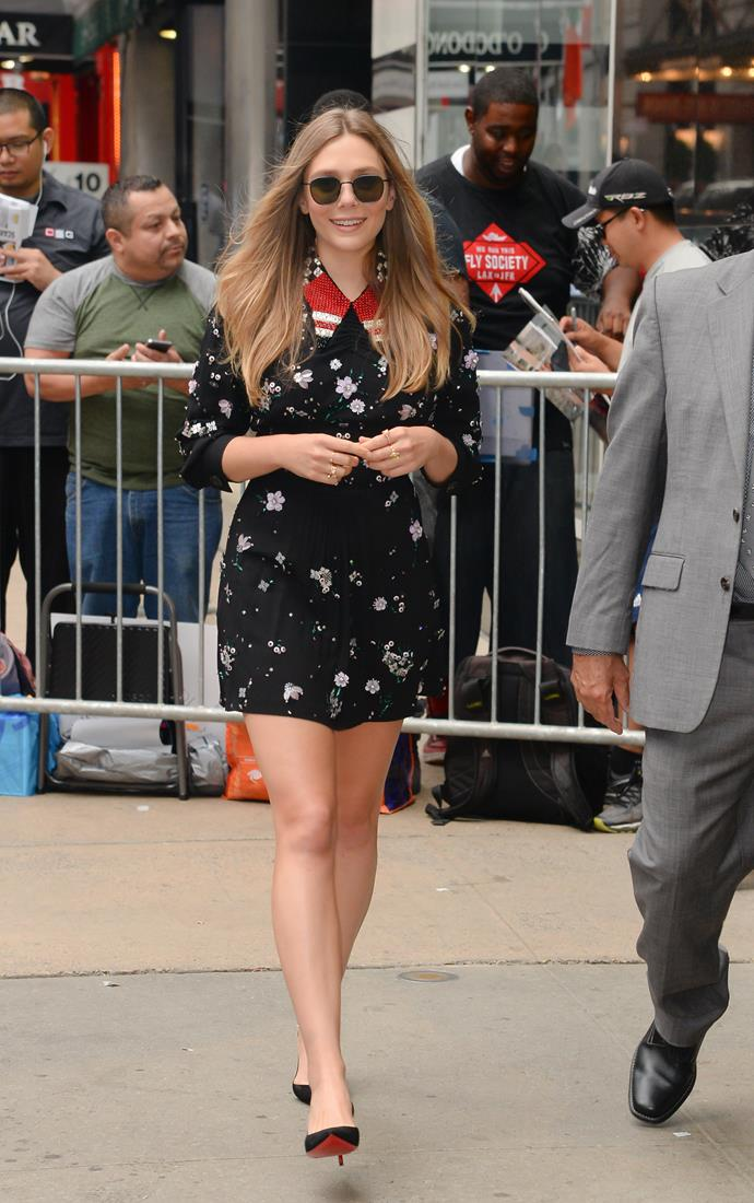 **Elizabeth Olsen** proves the statement collar still looks fresh in 2017, pairing her mini-dress with Christian Louboutin pumps while promoting her new film, *Ingrid Goes West*.
