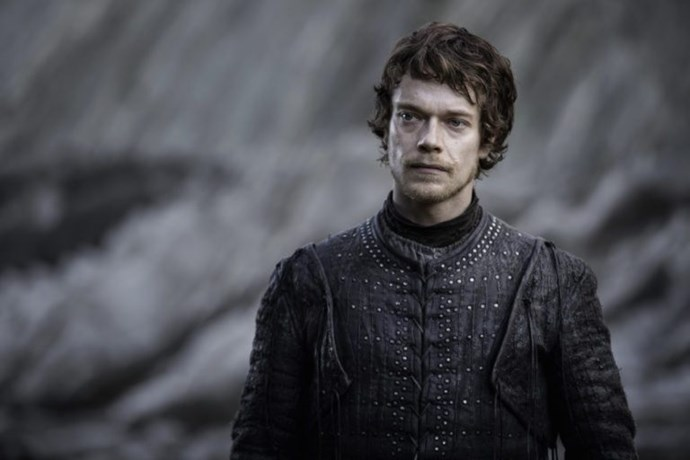 Theon Greyjoy is involved, which is a surprise, as after a full season of drama, we had sort of forgotten him. Last time we saw him he had just been dropped off at Dragonstone, which is when he had an awkward run in with Jon Snow. Based off the wall behind him, we can assume that he is still at Dragonstone and not at the meeting—as the Dragon pit meeting place is made of sandstone, rather than rock.