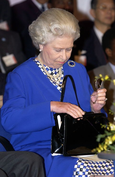 **...AND WHEN SHE PLACES HER PURSE ON A TABLE, DINNER IS OFFICIALLY OVER.** <br><br> If the Queen is at dinner and she puts her purse on the table, dinner needs to come to an end within five minutes.