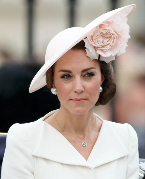 **CHIN PLACEMENT ISN'T OVERLOOKED.** <br><br> Royal women need to pose with their chin parallel to the ground.