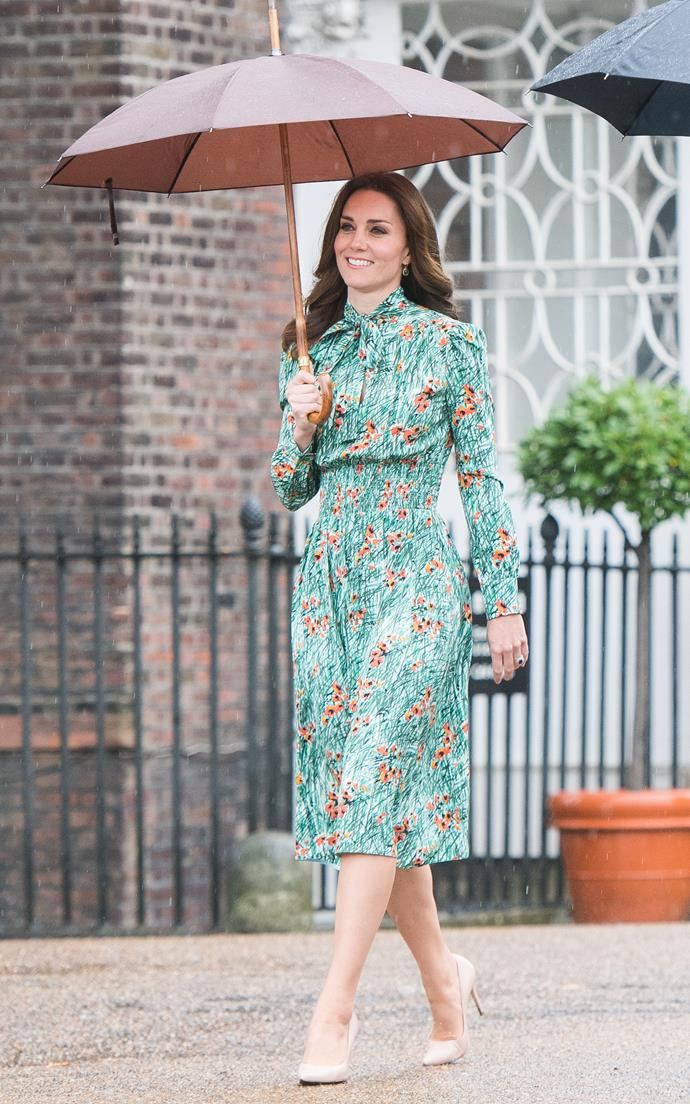 Kate Middleton chose a delightful Prada dress with floral details to visit The Sunken Garden at Kensington Palace. The garden is dedicated in memory to Princess Diana, and this visit was on the 20th anniversary of her passing.