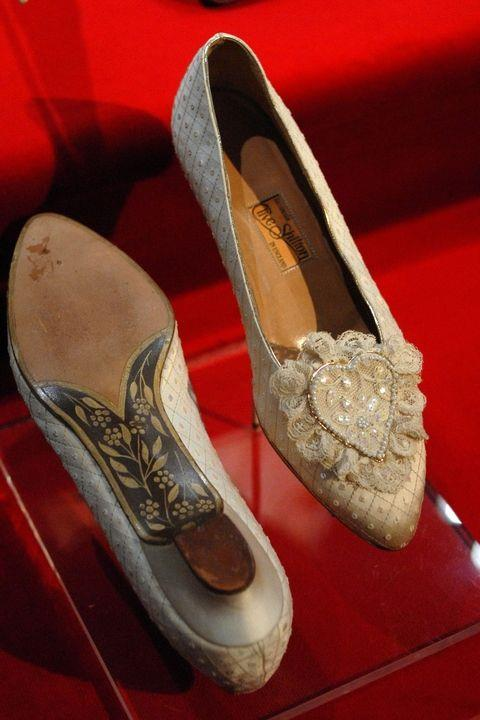 **Her shoes took six months to make.** <br><br> Barely visible beneath the hem of her gown, Diana's silk slippers included 542 sequins and 132 pearls in a heart-shaped design. Hand-painted soles included the initials C and D on the arch, but the heels themselves remained very low. At 5-foot-10, Diana stood at the same height as her fiancé!