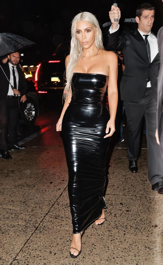 Kim donned a wet-look blonde wig and a fitted black latex dress to attend the Tom Ford spring summer '18 show in New York.