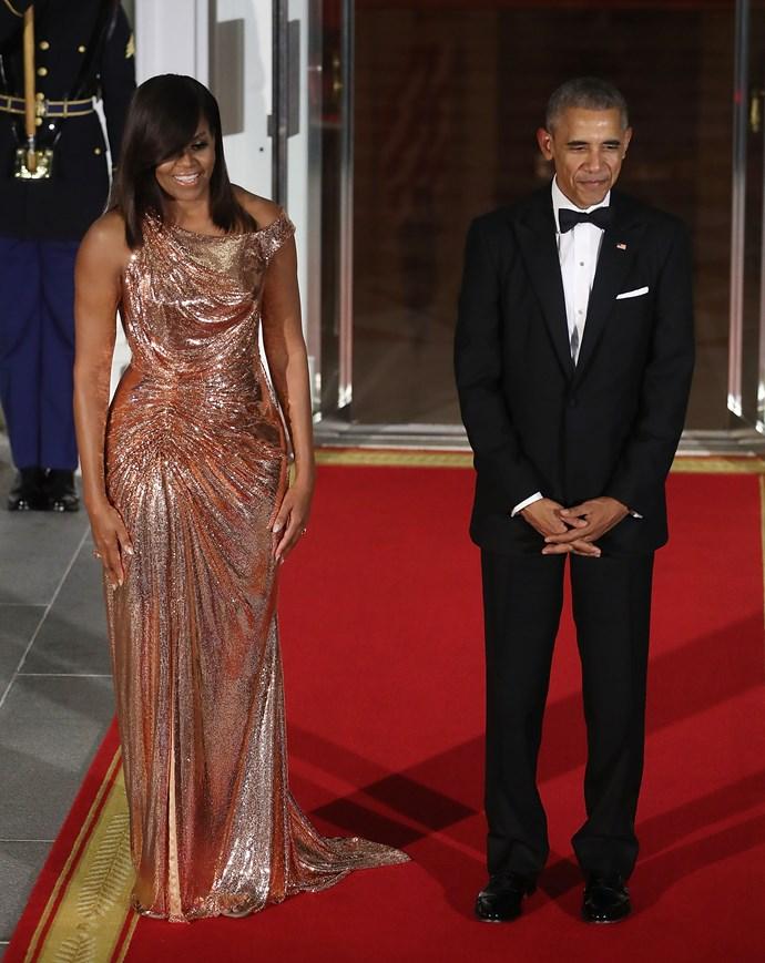 **Michelle Obama and Barack Obama**<br><br>  Michelle wears Versace.