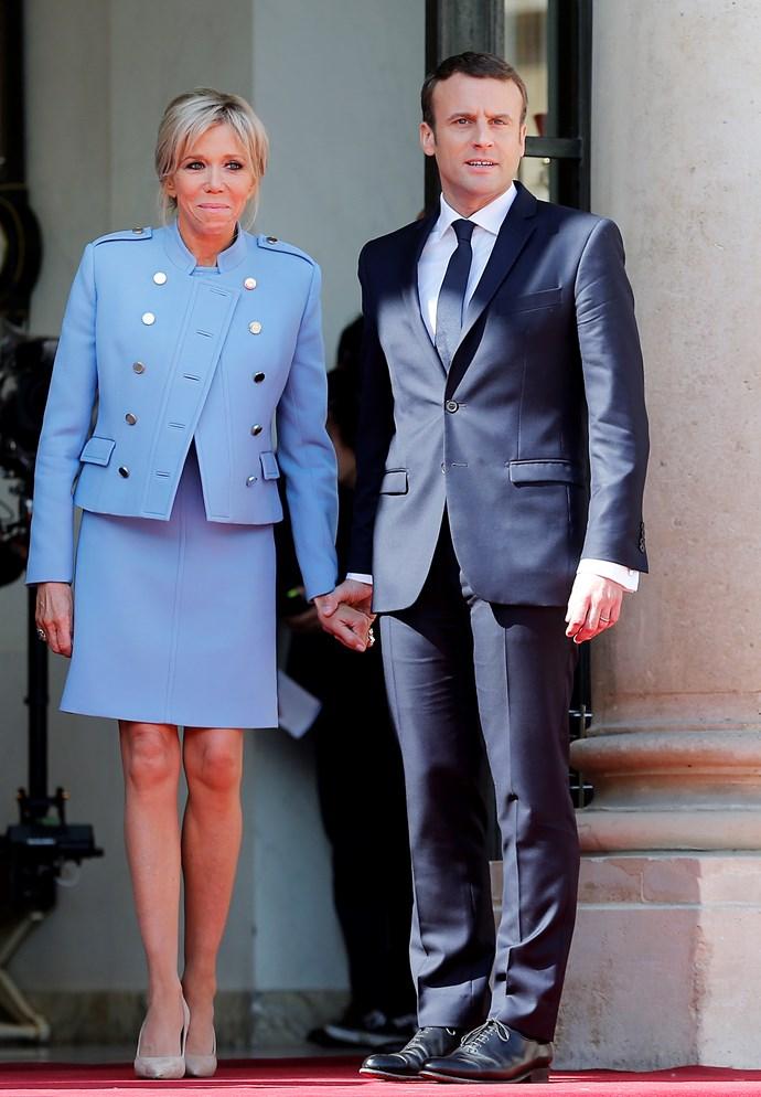 **Brigitte and Emanuel Macron**<br><br>  Brigitte wears Louis Vuitton.