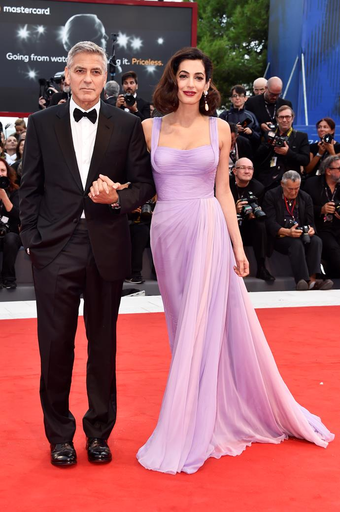 """**George Clooney and Amal Alamuddin** <br><br> George Clooney married Amal Alamuddin in 2014. The actor said told Ellen DeGeneres that the pair """"met in Lake Como. She was a friend of a friend who came to visit and then I chased her for many months, calling and writing, those kinds of things."""" The couple welcomed twins in June."""