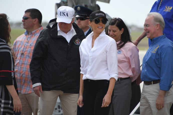 Following heavy criticism for her departure outfit, Melania Trump changed into a more practical outfit of jeans, white sneakers, a white button-down shirt and a 'Flotus' hat to visit victims of Hurricane Harvey in Texas.