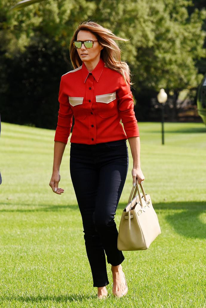 Melania wore a Calvin Klein 205W39 shirt (from Raf Simons' debut collection) and Hermès Birkin bag to return to the White House after visiting her husband at Camp David.