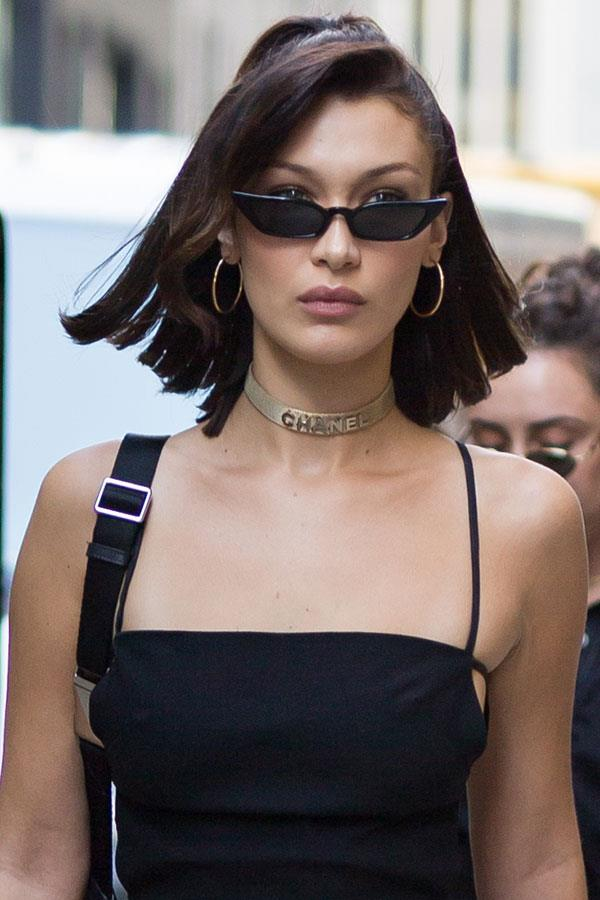 **Poppy Lissiman** <br><Br> Bella Hadid's been repping the same pair of minimalist black shades around New York fashion week, by none other than Perth designer Poppy Lissiman. Pre-order a pair of the edgy glasses [here](https://poppylissiman.com/collections/sunglasses/products/le-skinny-sunglasses-black?variant=43605098314) for $115.
