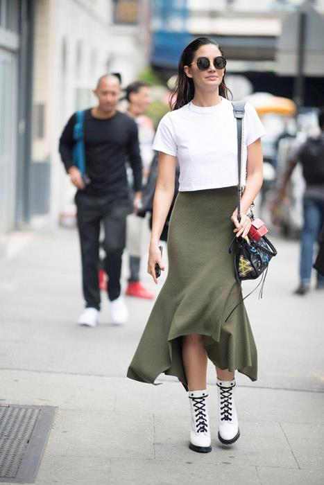 Play mix-master by teaming your heaviest, chunkiest winter boots with a fluted midi skirt and simple white tee.