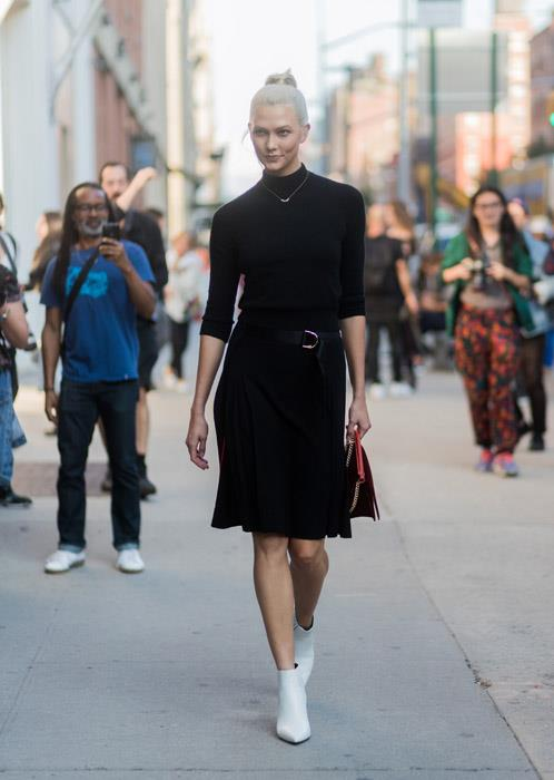 Karlie Kloss proves the power of this season's must-have shoe: the white ankle boot. Before you recoil in horror, think twice about how this unexpected shoe choice makes an otherwise ho-hum knit + skirt combo feel suddenly fresh.