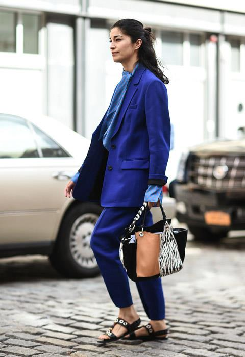 Bold, block coloured suiting is a big trend at New York fashion week, but we think Caroline Issa wore it best; teaming her cobalt two-piece with a pair of flat sandals and printed blouse in the same hue.