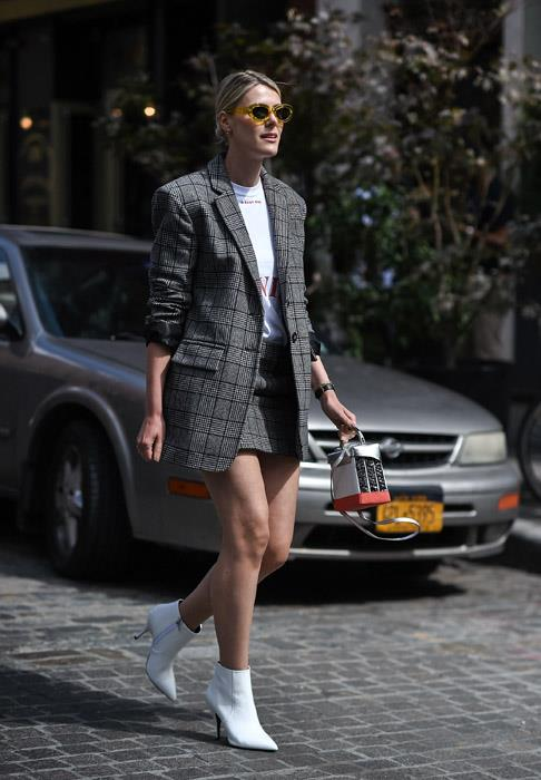 If you haven't already invested in a houndstooth or checked blazer, do it soon. And while you're at it, buy a matching skirt so you can wear the two together for a cool but polished work-day look.