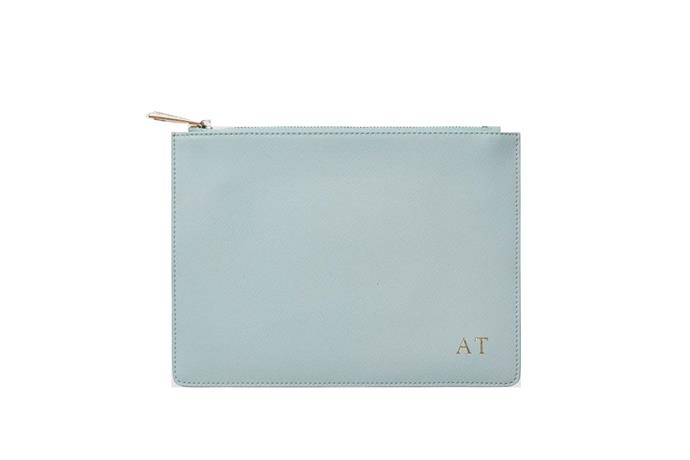 Monogrammed pouch, $90, TDE at [The Daily Edited](https://www.thedailyedited.com/ice-blue-pouch) <br><br> Small enough to carry your lipstick and phone, a monogrammed pouch like this can be used well after the wedding is over.