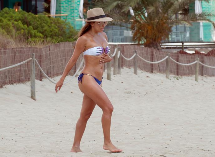 **EVA LONGORIA** <br><br> Longoria paired a white bikini top with royal blue bottoms on a family beach holiday in Ibiza in July. <br><br> **Image: Getty**