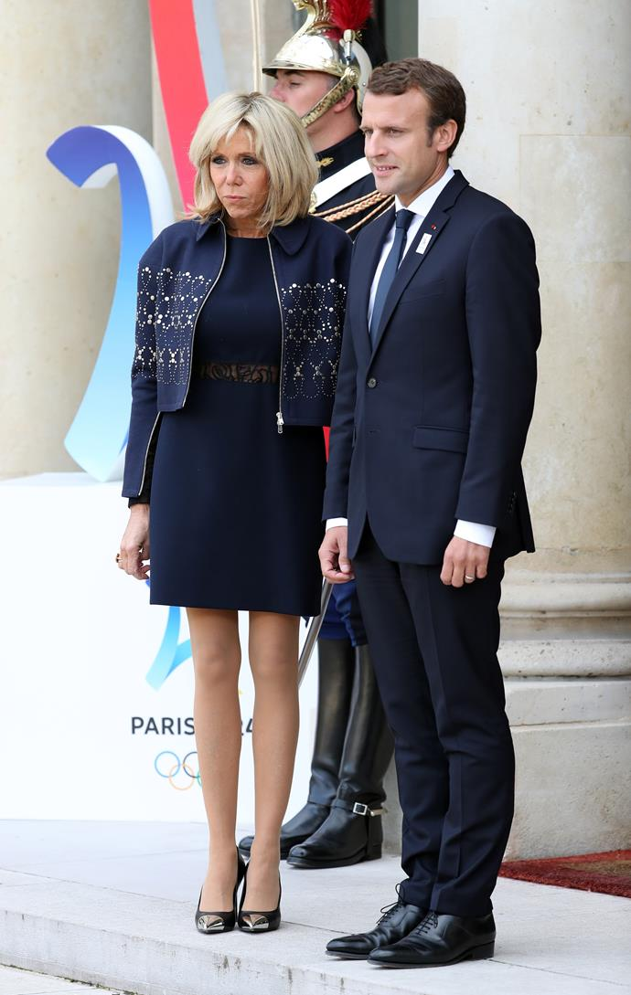 Brigitte opted for a navy mini dress and embellished cropped jacket, which she paired with Louis Vuitton pumps, at the Elysee Palace.