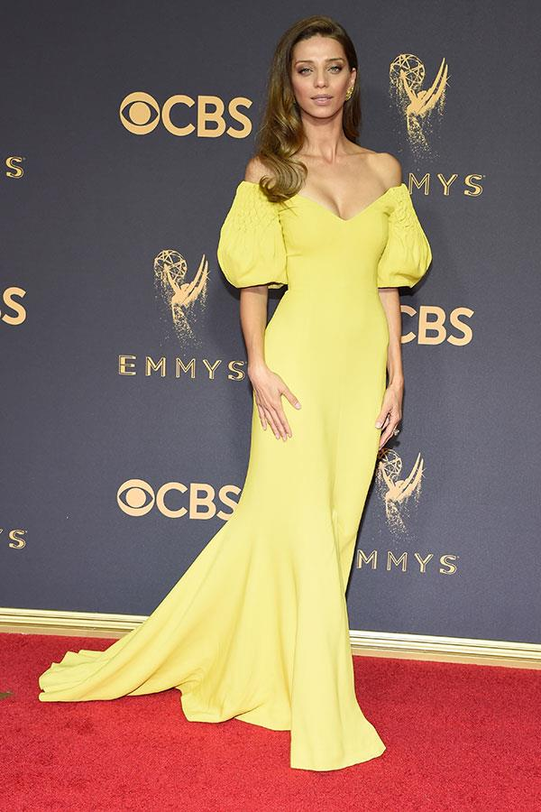 "**Angela Sarafyan in Elizabeth Kennedy:**   ""The dress's migraine-adjacent colour isn't helped by the ketchup-and-mustard effect against the red carpet."" — Tom Lazarus, chief sub editor   ""I don't care what anybody says, but I love this look. The neckline, the sleeves, and even—yes—the  colour. She pulls it off."" — Alison Izzo, digital managing editor"