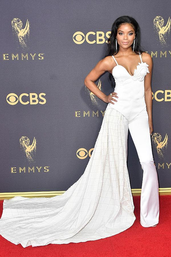 "**Ajiona-Alexus in:**   ""I'm confused, and I think so is her outfit. The ""*13 Reasons Why* star's look would've been stronger as either a full-skirted gown OR a pantsuit, not both."" — Alison Izzo, digital managing editor"