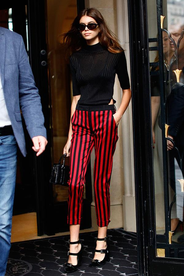 Kaia Gerber made a case for Beetlejuice-style trousers at Paris fashion week, teaming the statement piece with classic black accessories and a pair of Mary Janes (also by The Kooples).