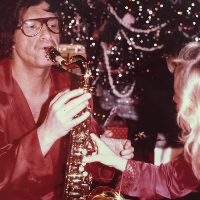 Playing the saxophone on Christmas day, 1997. From [Instagram](https://www.instagram.com/p/w2E3kSGP2V/?taken-by=hughhefner).