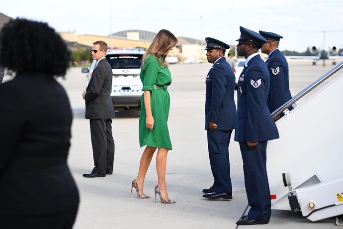 Melania wore a eye-grabbing green dress by former UK First Lady Samantha Cameron's label, Cefinn, during a visit to West Virginia.