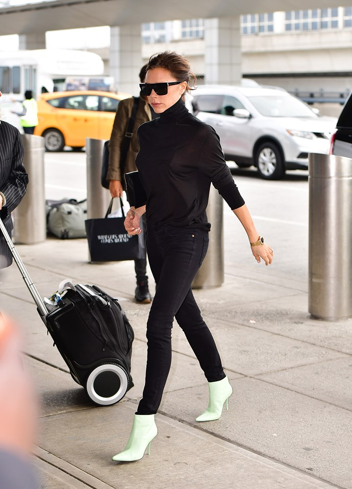Finally, she wore head-to-toe black with mint green ankle boots (mint was one of her preferred colours at SS '18), to depart New York and head back to Los Angeles.
