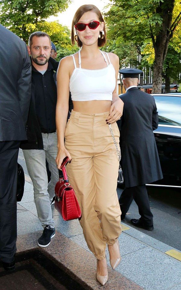 """**I.AM.GIA** <br><Br> Bella Hadid wore the same label at Paris fashion week, option for a nude colourway with silver chain detailing. <br><br> Available <a href=""""https://iamgia.com/collections/pants/products/cobain-cargo-tan"""">here</a> for $110."""