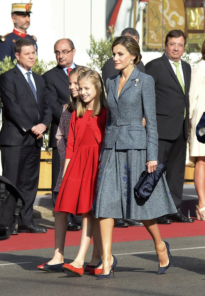 With her daughters, Princess Sofia of Spain and Princess Leonor of Spain at the National Day Military Parade.
