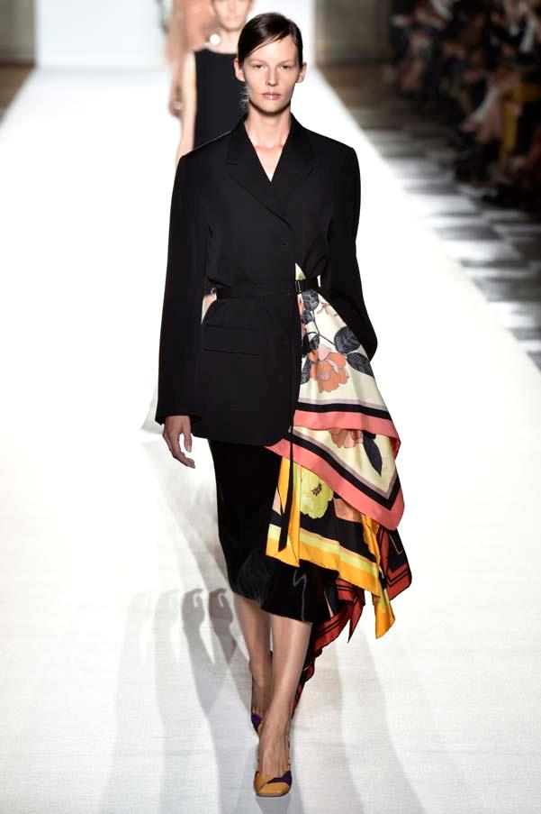 **Skirt suits**   Trust Dries Van Noten to bring fashion back down to earth with a infinitely wearable runway collection. The skirt suits were a highlight—perfectly tailored and styled with vibrant silk scarves. But Dries was far from the only designer to embrace the trend, they were also spotted everywhere from Off-White to Chanel.   Dries Van Noten spring summer '18