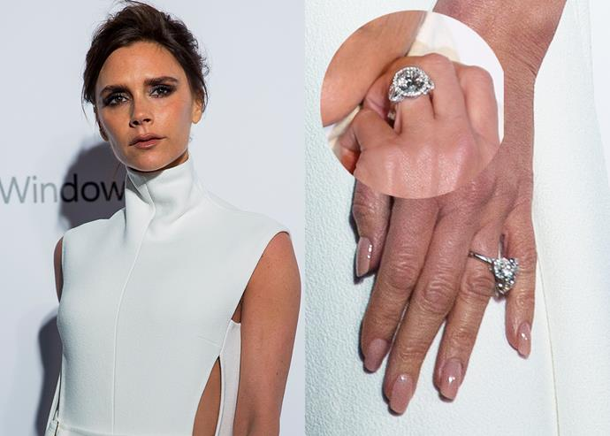 ***2015: The round-cut diamond with a halo setting and round side stones***   In 2015, VB enjoyed a short-lived love affair with a round-cut diamond set in a halo design with two round side stones. She wore it steadily for a few months before putting it in the vaults.