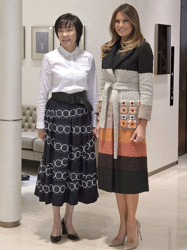 Melania Trump wearing an embellished Fendi coat and neutral Manolo Blahnik pumps meeting Akie Abe, the wife of Japanese Prime Minister Shinzō Abe, in Tokyo.