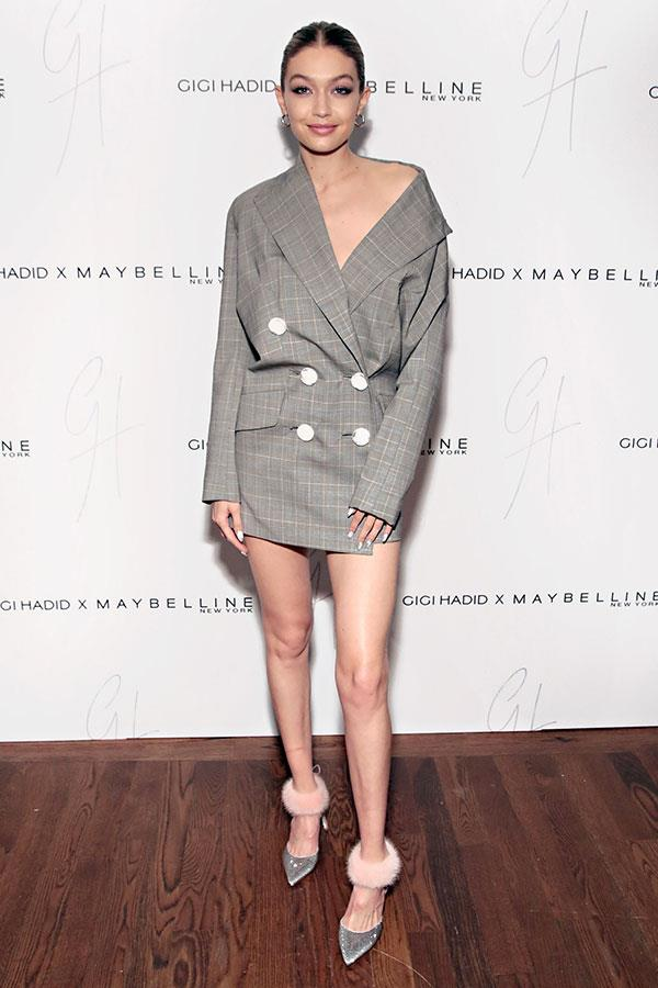 Wearing an oversized 'drazer' (blazer dress, for the uninitiated) and a pair of furry Rene Caovilla heels at the launch of her Gigi Hadid x Maybelline New York beauty line.