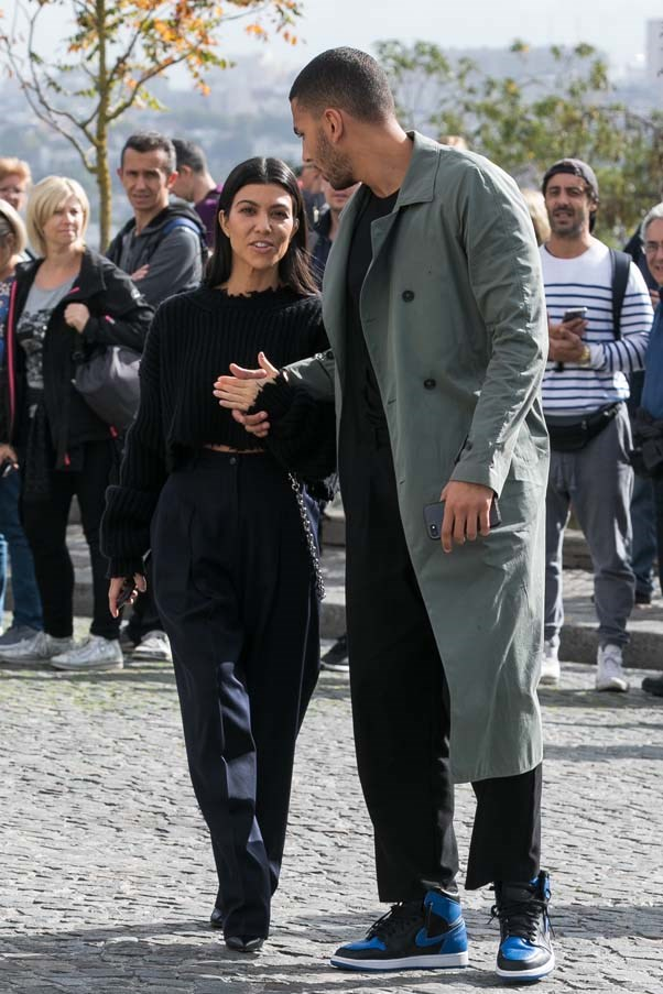 Outside Haider Ackermann with boyfriend Younes Bendjima, September 2017.