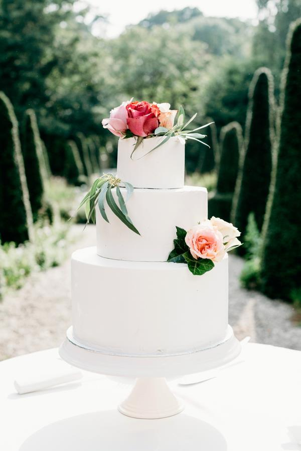 **On the cake: **Our cake by Story River was just perfect–crisp white with some nude roses. It was a three layer vanilla cake with butter cream and a white chocolate and fresh raspberry filling. The taste was amazing, and even better the day after.