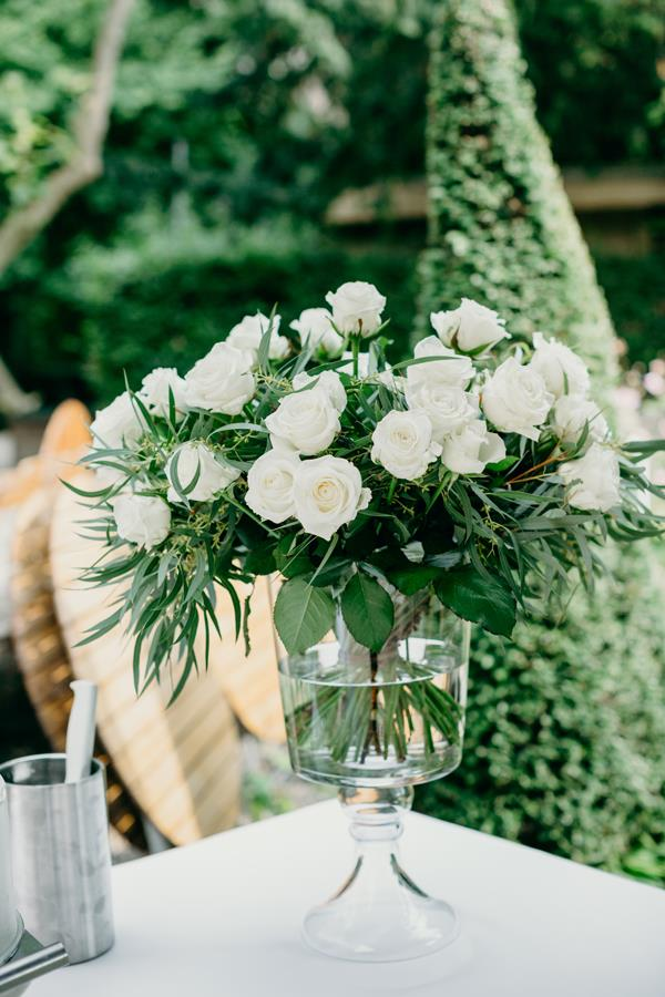 **On the flowers: **We used white roses, as there is such elegance and purity about them. A close friend of my parents was our florist. It's really nice to work with people you know personally, we were so happy to have her.