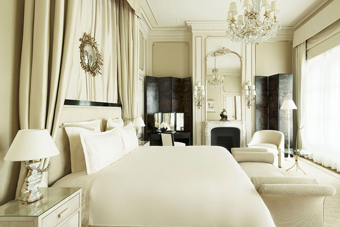 "**Coco Chanel Suite Ritz Paris** <br><br> Coco Chanel called the Ritz Paris her home for 34 years. So, when the Ritz underwent a four-year restoration and reopened in 2016, it was only fitting that they opened a two bedroom Coco Chanel Suite. It features a neutral colour palette, completed with baroque mirrors and a view of the Palace Vendome, which inspired the shape of the Chanel No.5 perfume bottle.  <br><br> Image via [Ritz Paris](  https://www.ritzparis.com/en-GB/luxury-hotel-paris/prestige-suites/coco-chanel-suite|target=""_blank"")."