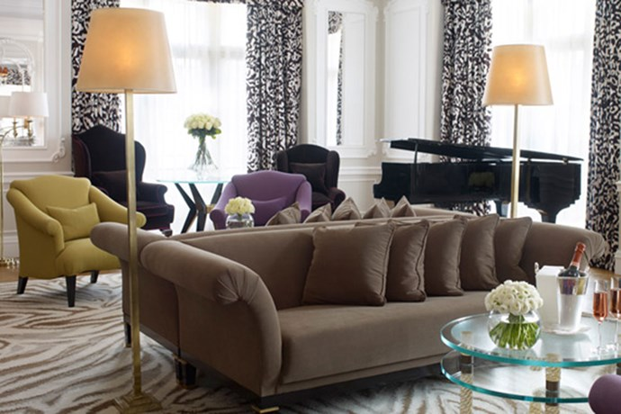 "**Clairdges London** <br><br> Claridge's Grand Piano suite was designed by Diane von Furstenberg and features sophisticated animal prints on curtains, rugs, sofas and pillows. It is also furnished with marble fireplaces and a dark, yet, vibrant colour palette. It stays true to the aesthetic of the DVF brand.  <br><br> Image via [Claridges London](  http://www.claridges.co.uk/luxury-accommodation/hotel-suites/grand-piano-suite/ |target=""_blank"")."
