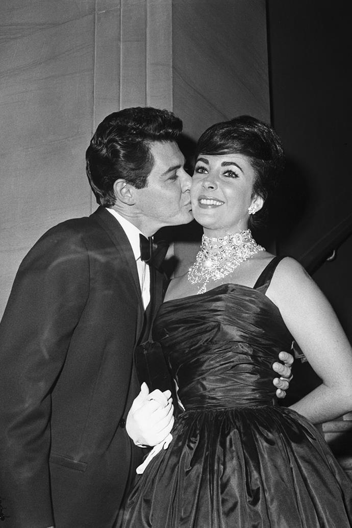 **Elizabeth Taylor and Eddie Fisher** <br><br> One of the biggest scandals of the 1950s was the affair between Elizabeth Taylor and Eddie Fisher. Fisher, who was married to Debbie Reynolds at the time, comforted Taylor when her husband Mike Todd died—and later fell for the actress. He divorced Reynolds and married Taylor in 1959. However, just five years later Taylor divorced Fisher for her *Cleopatra* co-star Richard Burton. They were married in 1964.