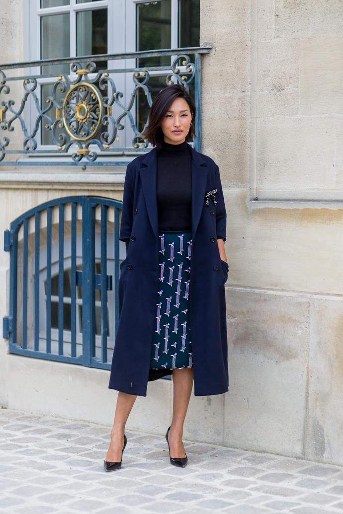 **MAKE YOUR PENCIL SKIRT EXCITING** <br><br> Picking out a pencil skirt doesn't need to be as mundane a task as it may seem—try to find something streamlined that also makes use of a vibrant pattern or unique fabric (seen here paired with a turtleneck and trench coat on **Nicole Warne**).