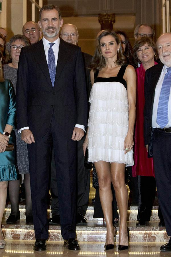 Queen Letizia of Spain stepped out at the Francisco Cerecedo Journalism Award in Madrid wearing a tiered mini dress that finishes above the knee, a length considered 'too short' by the English royal family's style rules, the same guidelines that the likes of Kate Middleton has to adhere to.